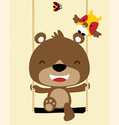 Funny little bear cartoon playing swing with its vector