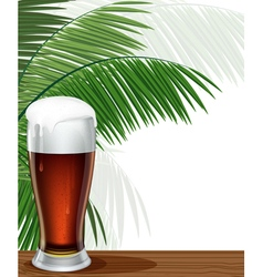 Glass beer and palm branches vector
