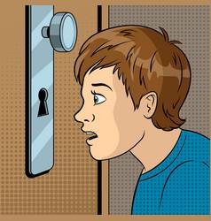 boy peeks into the keyhole pop art vector image