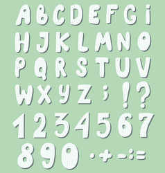 Cute letters and numbers are cut out checkered vector