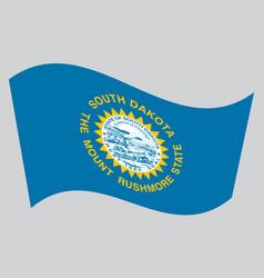 flag of south dakota waving on gray background vector image vector image