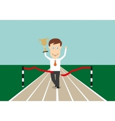 Businessman crossing finish line with trophy cup vector image