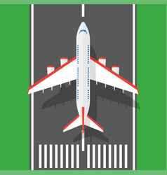 Airplane on a runway in top view vector