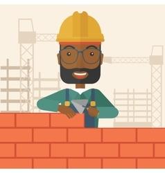 Black builder man is building a brick wall vector