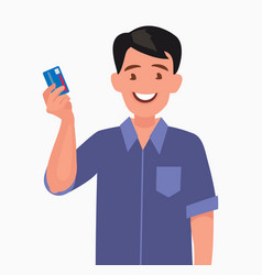 man holds a credit card in his hand vector image