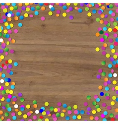 Wood background with confetti vector