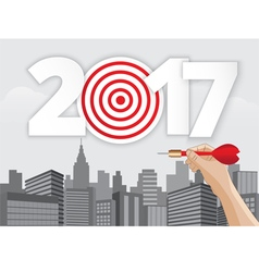 hand holding dart aiming at the business target vector image