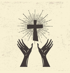Hands raised to the cross of jesus vector