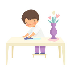 Boy wiping table with rag kid helping with home vector