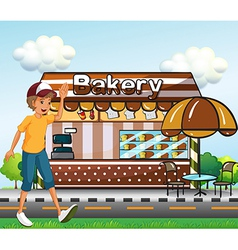 A boy walking across the bakery vector image