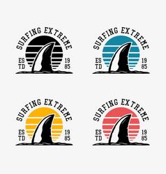 Logo design surfing extreme est 1985 with shark vector