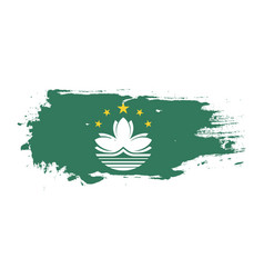Grunge brush stroke with macau national flag vector