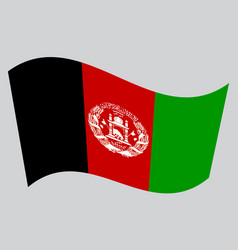 Flag of afghanistan waving on gray background vector