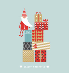 little christmas gnome with gift boxes vector image