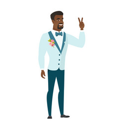 African groom showing the victory gesture vector