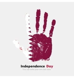 Handprint with the Flag of Qatar in grunge style vector