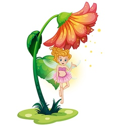 A fairy flying under the giant flower vector image vector image
