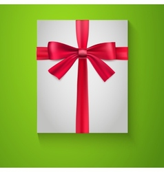 Gift wrapping with red bow and ribbon top view vector image