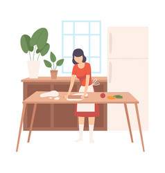 woman rolls out dough on kitchen table vector image