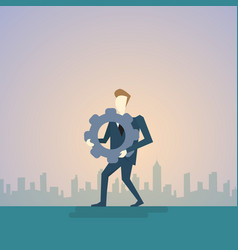 business man hold cog wheel ponder think strategy vector image