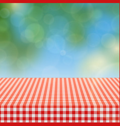 Picnic table with red checkered pattern linen vector