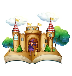 A storybook with a castle and a witch vector
