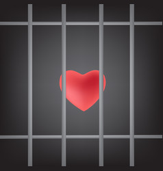 Dramatic red heart was imprisoned in prison bars vector
