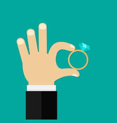male hands holding engagement ring flat style vector image