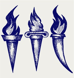 Set of flaming torches vector image vector image
