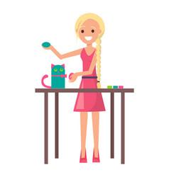 Joyful blonde girl with cute handicraft kitten vector