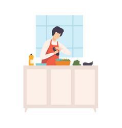 Person in an apron sprinkles salad in kitchen vector