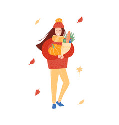 young woman in autumn clothes carrying grocery vector image