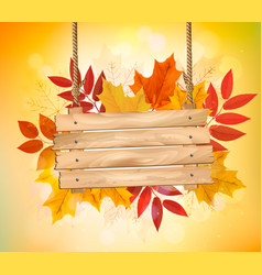 Autumn background with leaves and wooden sign vector