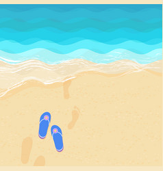 flip flops and footsteps on the sand vector image