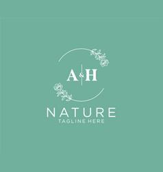 Initial ah letters botanical feminine logo vector