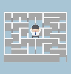 Businessman standing in center of the maze vector