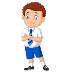 Cartoon school boy in uniform posing vector