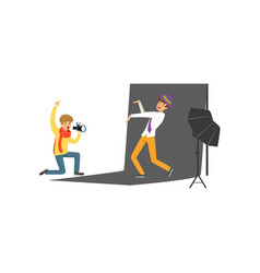 photographer sitting on his knee and holding vector image