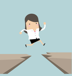 Businesswoman jump through the gap from cliff vector