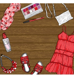 Wooden background with red female fashion clothes vector
