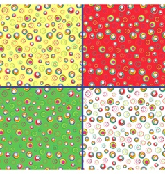 Four seamless patterns with colorful circles vector