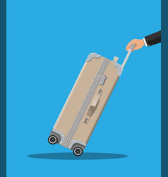 Travel bag in hand trolley on wheels vector