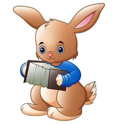 cute rabbit cartoon playing the accordion vector image