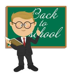 primary schoolboy standing next to blackboard vector image