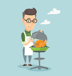 man cooking chicken on barbecue grill vector image vector image