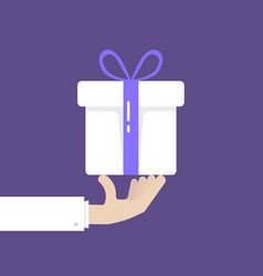 Hand holding white gift box donation vector