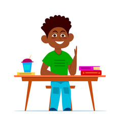Multiethnic boy at school desk in classroom vector