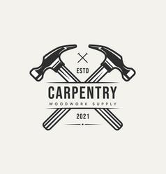 Cross hammer carpentry vintage logo icon design vector