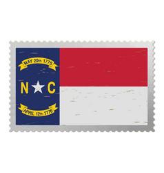 North carolina us flag on old postage stamp vector