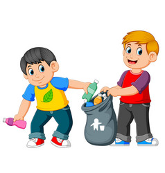two boys collecting rubbish vector image